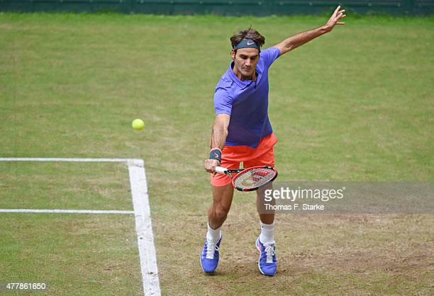 Roger Federer of Switzerland plays a backhand in his match against Ivo Karlovic of Croatia during day six of the Gerry Weber Open at Gerry Weber...