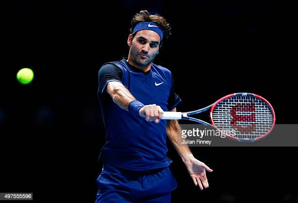 Roger Federer of Switzerland plays a backhand in his men's singles match against Novak Djokovic of Serbia during day three of the Barclays ATP World...