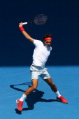 Roger Federer of Switzerland plays a backhand in his third round match against Teymuraz Gabashvili of Russia during day six of the 2014 Australian...