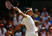 Roger Federer of Switzerland plays a backhand in the Gentlemens Singles Semi Final match against Andy Murray of Great Britain during day eleven of...