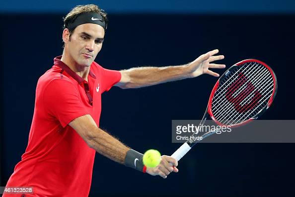 Roger Federer of Switzerland plays a backhand in the Mens final match against Milos Raonic of Canada during day eight of the 2015 Brisbane...