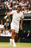 Roger Federer of Switzerland plays a backhand return during his Gentlemen's Singles third round match against Santiago Giraldo of Colombia on day six...