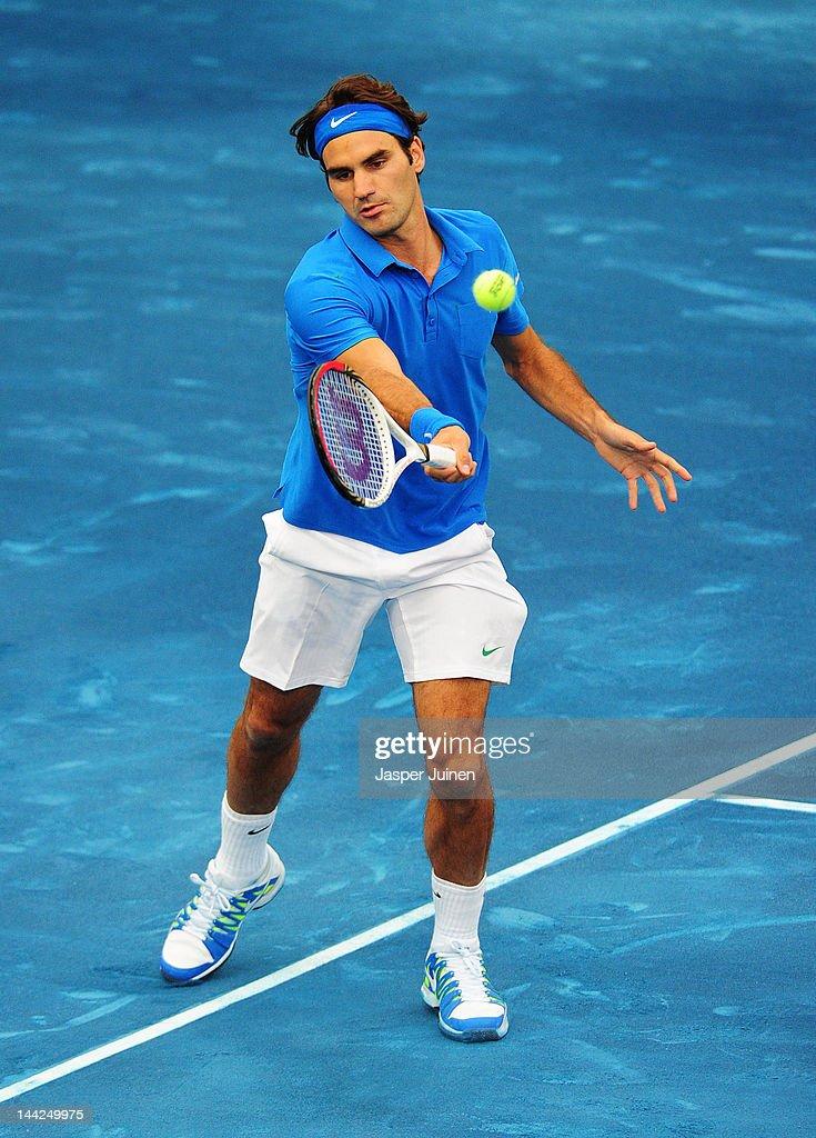 Roger Federer of Switzerland plays a backhand to Janko Tipsarevic of Serbia in his semi final match during the Mutua Madrilena Madrid Open tennis tournament at the Caja Magica on May 12, 2012 in Madrid, Spain.