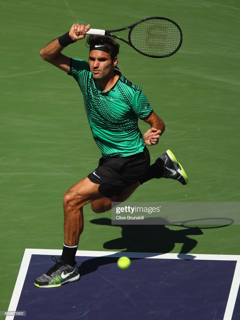 Roger Federer of Switzerland plays a forehand against Jack Sock of the United States in their semi final match during day thirteen of the BNP Paribas Open at Indian Wells Tennis Garden on March 18, 2017 in Indian Wells, California.