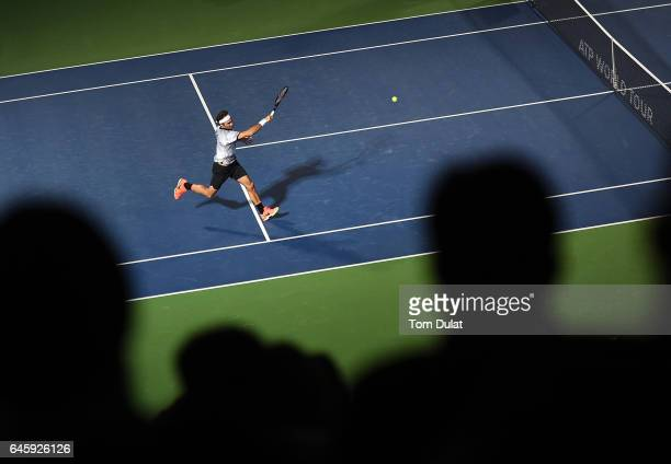 Roger Federer of Switzerland plays a forehand during his match against Benoit Paire of France on day two of the ATP Dubai Duty Free Tennis...