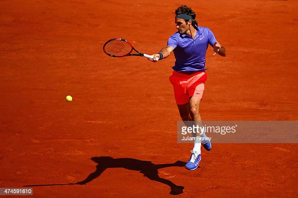 Roger Federer of Switzerland plays a forehand during his Men's Singles match against Alejandro Falla of Colombia on day one of the 2015 French Open...