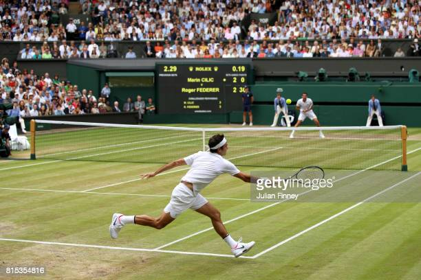 Roger Federer of Switzerland plays a forehand during the Gentlemen's Singles final against Marin Cilic of Croatia on day thirteen of the Wimbledon...