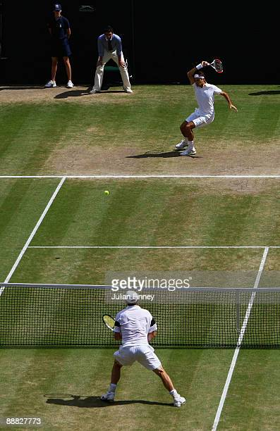 Roger Federer of Switzerland plays a forehand during the men's singles final match against Andy Roddick of USA on Day Thirteen of the Wimbledon Lawn...
