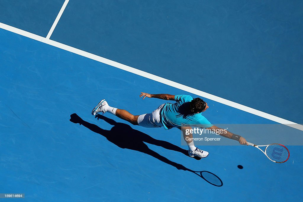 Roger Federer of Switzerland plays a forehand in his first round match against Benoit Paire of France during day two of the 2013 Australian Open at Melbourne Park on January 15, 2013 in Melbourne, Australia.
