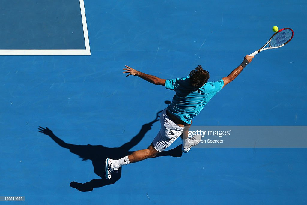 <a gi-track='captionPersonalityLinkClicked' href=/galleries/search?phrase=Roger+Federer&family=editorial&specificpeople=157480 ng-click='$event.stopPropagation()'>Roger Federer</a> of Switzerland plays a forehand in his first round match against Benoit Paire of France during day two of the 2013 Australian Open at Melbourne Park on January 15, 2013 in Melbourne, Australia.