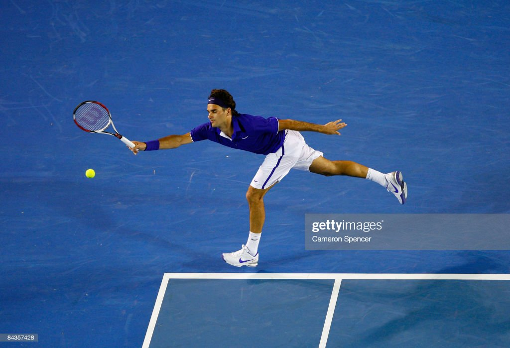 Roger Federer of Switzerland plays a forehand in his first round match against Andreas Seppi of Italy during day one of the 2009 Australian Open at Melbourne Park on January 19, 2009 in Melbourne, Australia.