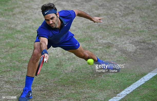 Roger Federer of Switzerland plays a forehand in his half final match against Alexander Zverev of Germany during day six of the Gerry Weber Open at...