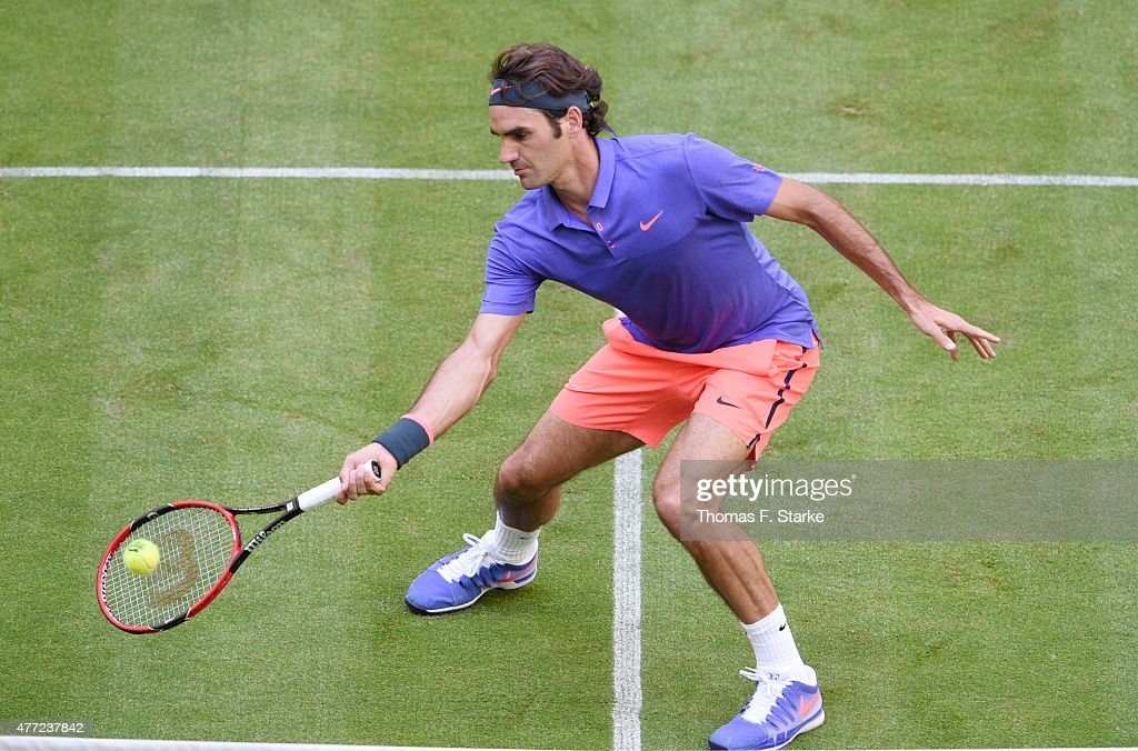 Roger Federer of Switzerland plays a forehand in his match against Philipp Kohlschreiber of Germany during day one of the Gerry Weber Open at Gerry...