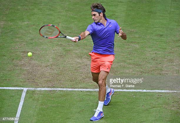 Roger Federer of Switzerland plays a forehand in his match against Ernests Gulbis of Latvia during day three of the Gerry Weber Open at Gerry Weber...