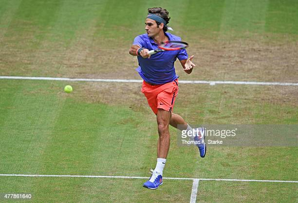 Roger Federer of Switzerland plays a forehand in his match against Ivo Karlovic of Croatia during day six of the Gerry Weber Open at Gerry Weber...