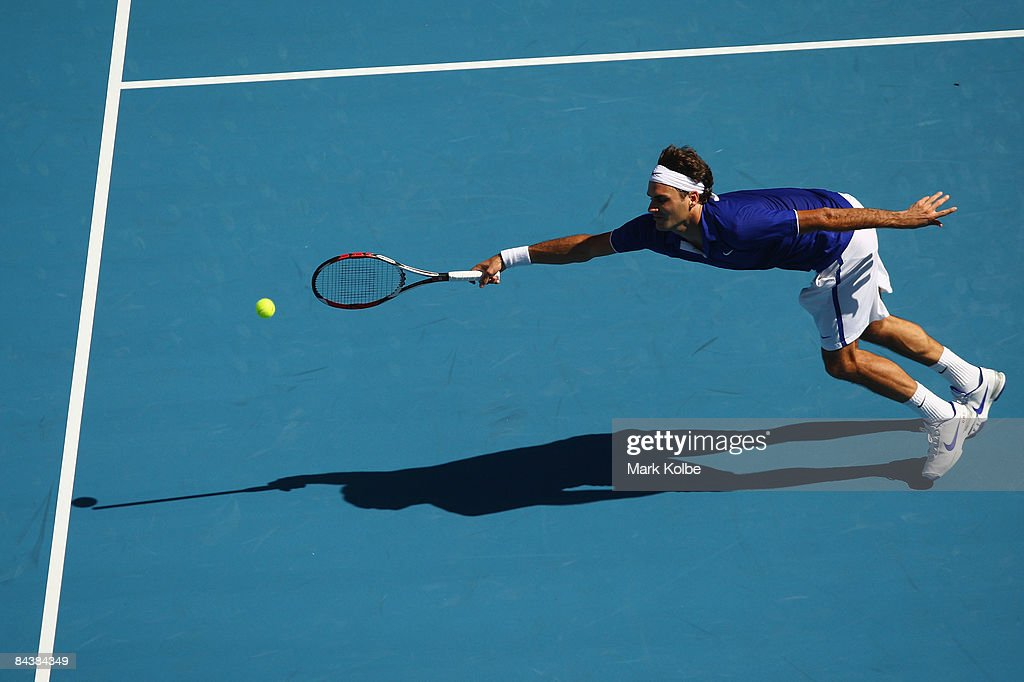<a gi-track='captionPersonalityLinkClicked' href=/galleries/search?phrase=Roger+Federer&family=editorial&specificpeople=157480 ng-click='$event.stopPropagation()'>Roger Federer</a> of Switzerland plays a forehand in his second round match against Evgeny Korolev of Russia during day three of the 2009 Australian Open at Melbourne Park on January 21, 2009 in Melbourne, Australia.