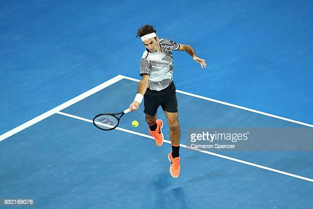 Roger Federer of Switzerland plays a forehand in his third round match against Thomas Berdych of the Czech Republic on day five of the 2017...