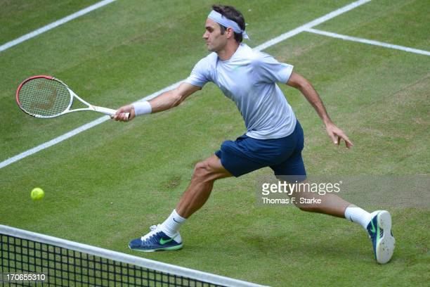 Roger Federer of Switzerland plays a forehand in the final match against Mikhail Youzhny of Russia during the final day of the Gerry Weber Open at...
