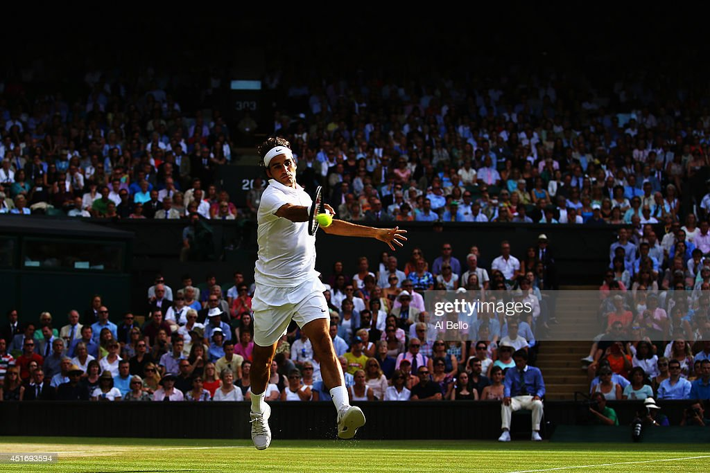 Roger Federer of Switzerland plays a forehand return during his Gentlemen's Singles semi-final against Milos Raonic of Canada on day eleven of the Wimbledon Lawn Tennis Championships at the All England Lawn Tennis and Croquet Club on July 4, 2014 in London, England.