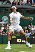 Roger Federer of Switzerland plays a forehand shot the Men's Singles first round match against Giodo Pella of Argentina on day one of the Wimbledon...
