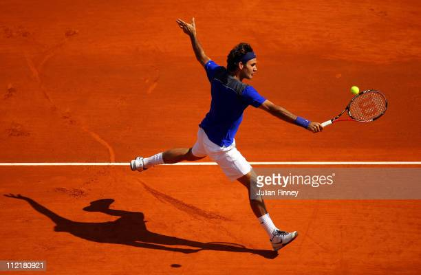 Roger Federer of Switzerland plays a volley in his match against Marin Cilic of Croatia during Day Five of the ATP Masters Series Tennis at the Monte...