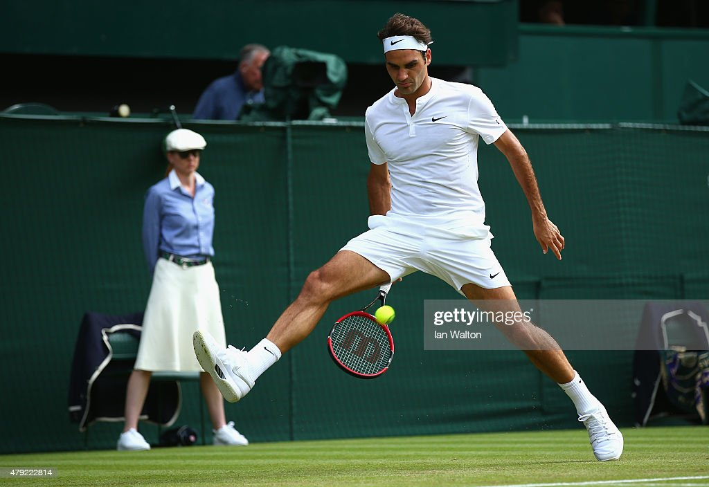 <a gi-track='captionPersonalityLinkClicked' href=/galleries/search?phrase=Roger+Federer&family=editorial&specificpeople=157480 ng-click='$event.stopPropagation()'>Roger Federer</a> of Switzerland plays a whot through the legs during his Gentlemens Singles Second Round match against Sam Querry of the United States during day four of the Wimbledon Lawn Tennis Championships at the All England Lawn Tennis and Croquet Club on July 2, 2015 in London, England.