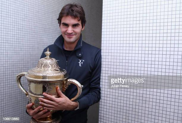 Roger Federer of Switzerland poses for a photo with the trophy after defeating Novak Djokovic of Serbia in the final during Day Seven of the Davidoff...