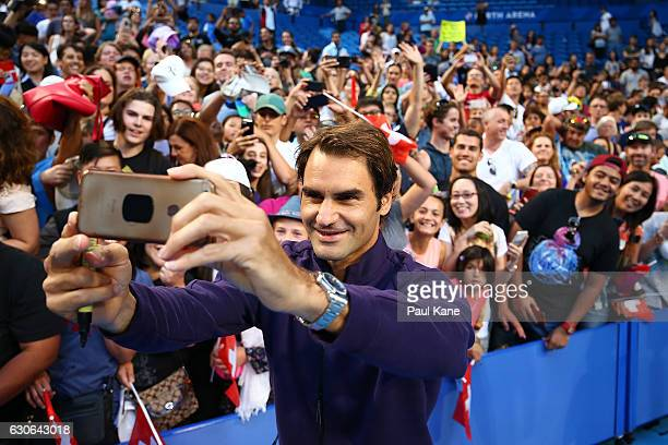 Roger Federer of Switzerland poses for a selfie with spectators after a practice session at the Perth Arena on December 29 2016 in Perth Australia