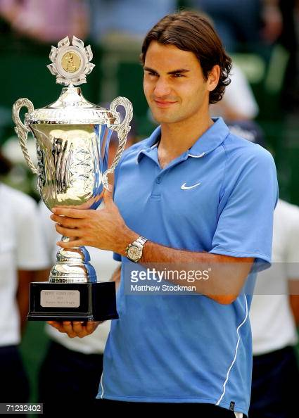 Roger Federer of Switzerland poses for photographers with the winner's trophy after defeating Tomas Berdych of the Czech Republic during the Gerry...