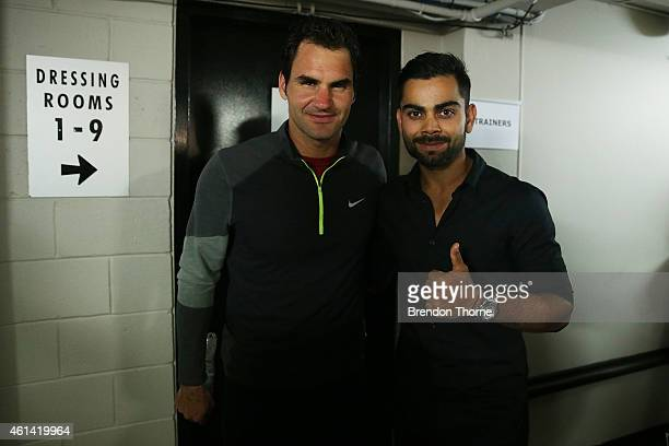 Roger Federer of Switzerland poses with Indian test cricket captain Virat Kohli following his match against Lleyton Hewitt of Australia at Qantas...