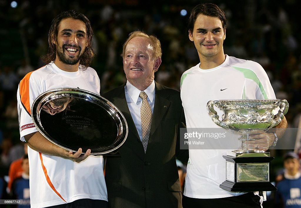 Roger Federer of Switzerland poses with Rod Laver and Marcos Baghdatis of Cyprus after victory in his Men's Singles Final match against Marcos Baghdatis of Cyprus during day fourteen of the Australian Open at Melbourne Park January 29, 2006 in Melbourne, Australia.