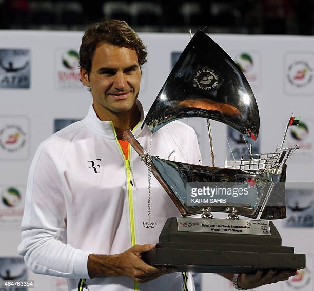 Roger Federer of Switzerland poses with the ATP Dubai Duty Free Tennis Championships trophy after defeating World number one Novak Djokovic of Serbia...
