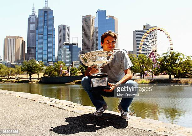 Roger Federer of Switzerland poses with the Australian Open 2010 winners trophy on Boathouse Drive on February 1 2010 in Melbourne Australia