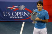 Roger Federer of Switzerland poses with the championship trophy after defeating Andy Roddick in the men's final of the US Open at the USTA Billie...