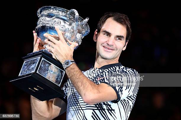 Roger Federer of Switzerland poses with the Norman Brookes Challenge Cup after winning the Men's Final match against Rafael Nadal of Spain on day 14...