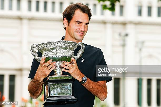Roger Federer of Switzerland poses with the Norman Brookes Challenge Cup after winning the 2017 Australian Open Men's Singles Final on January 30...