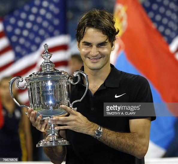 Roger Federer of Switzerland poses with the trophy after defeating Novak Djokovic of Serbia 76 76 64 to win the US Open men's title for a fourth...