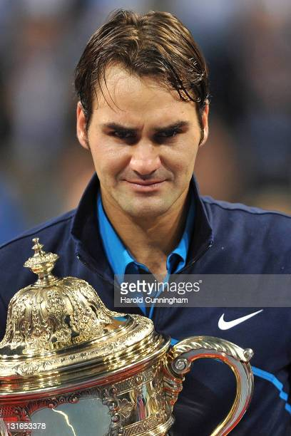 Roger Federer of Switzerland poses with the trophy as he celebrates his victory after defeating Kei Nishikori of Japan during the final on day seven...