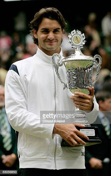 Roger Federer of Switzerland poses with the trophy as he celebrates his victory against Marat Safin of Russia in the final of the Gerry Weber Open...