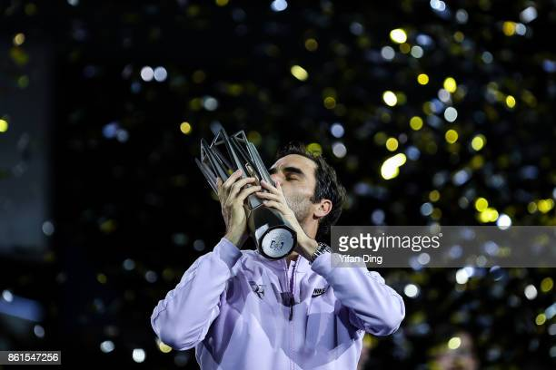 Roger Federer of Switzerland poses with the trophy during the award ceremony after winning his Men's singles final match against Rafael Nadal of...