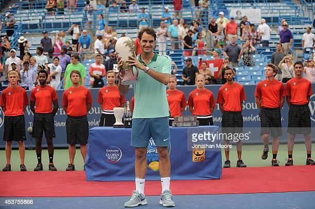 Roger Federer of Switzerland poses with the winner's trophy after a final match against David Ferrer of Spain on day 9 of the Western Southern Open...