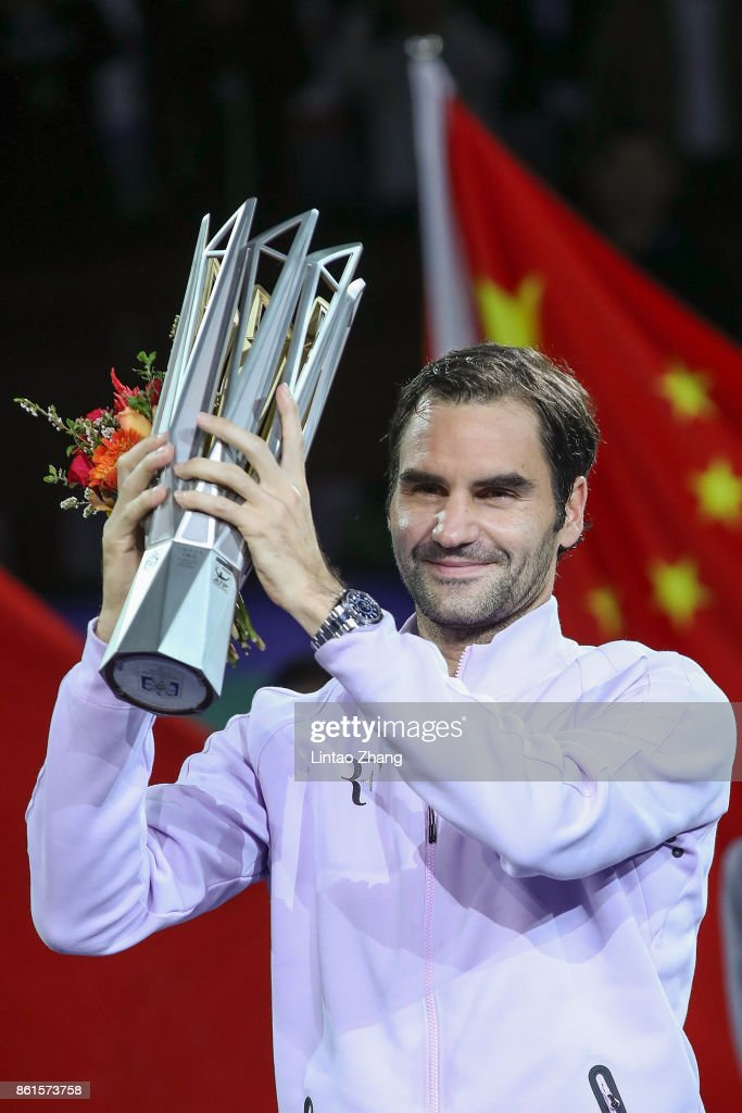 Roger Federer of Switzerland poses with the winner's trophy after defeating Rafael Nadal of Spain duirng the Men's singles final mach on day eight of 2017 ATP Shanghai Rolex Masters at Qizhong Stadium on October 15, 2017 in Shanghai, China.