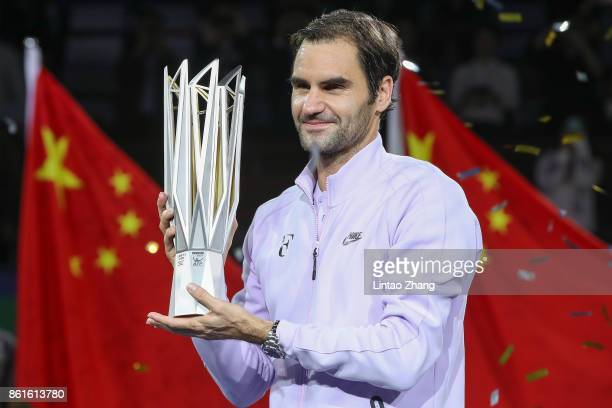 Roger Federer of Switzerland poses with the winner's trophy after defeating Rafael Nadal of Spain during the Men's singles final mach on day eight of...