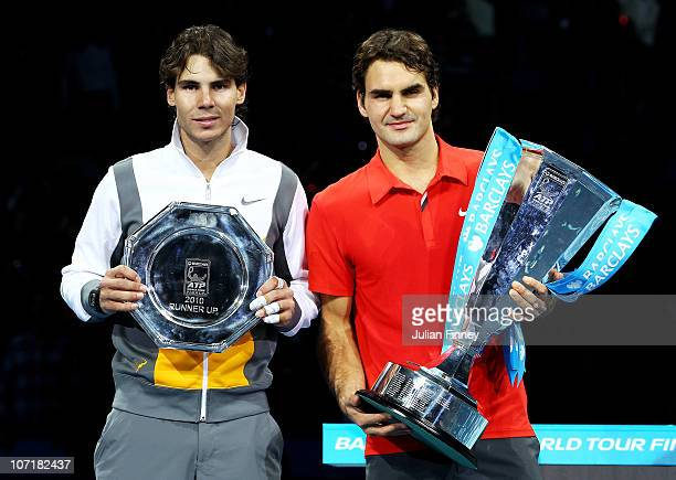 Roger Federer of Switzerland poses with the winners trophy and Rafael Nadal of Spain after their men's final match during the ATP World Tour Finals...