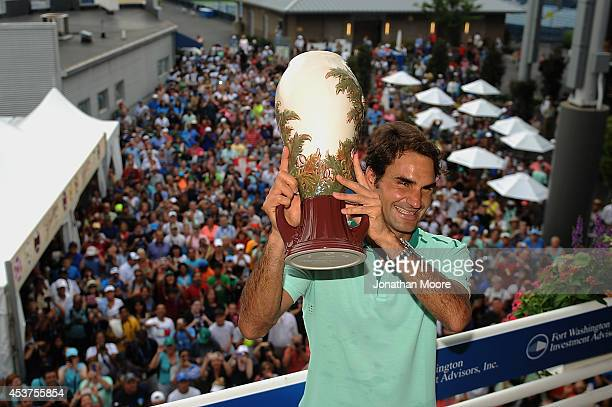 Roger Federer of Switzerland poses with the winner's trophy on Champion's Balcony after a final match against David Ferrer of Spain on day 9 of the...