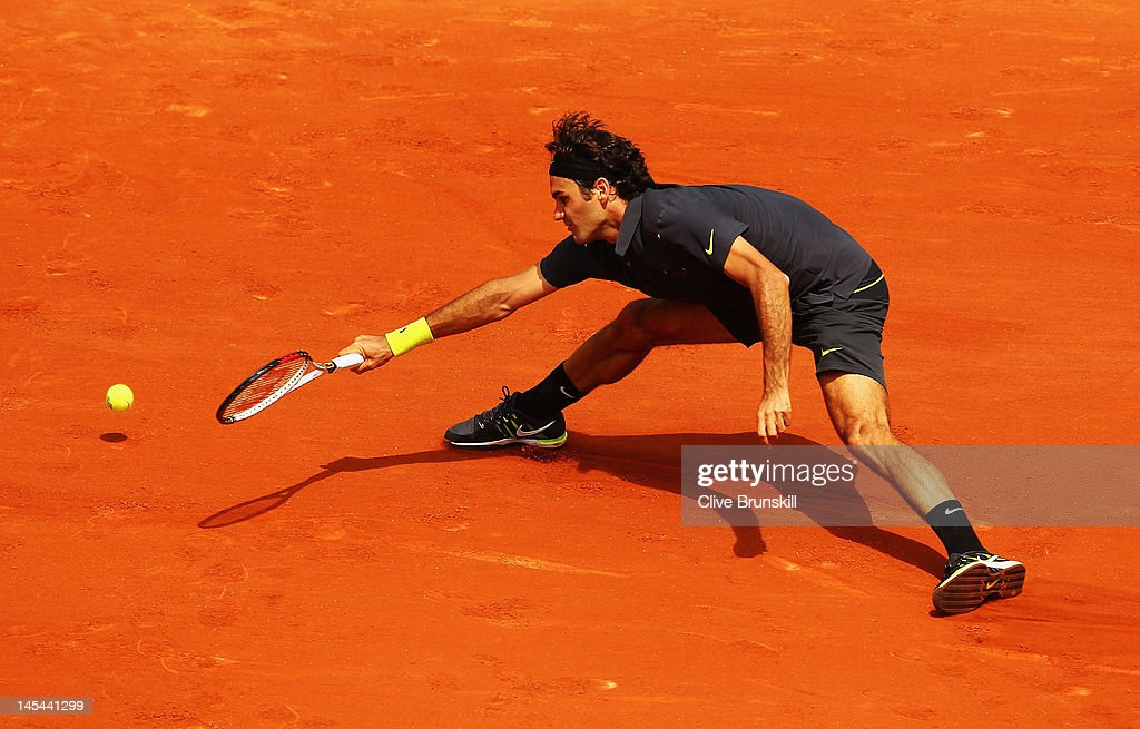 Roger Federer of Switzerland reaches for a forehand during his men's singles second round match against Adrian Ungur of Romania during day four of the French Open at Roland Garros on May 30, 2012 in Paris, France.