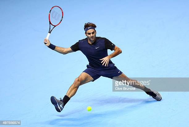 Roger Federer of Switzerland reaches for a forehand in his men's singles match against Novak Djokovic of Serbia during day three of the Barclays ATP...