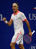 Roger Federer of Switzerland reacts to winning the second set against John Isner of the United States during their Men's Singles Fourth Round match...
