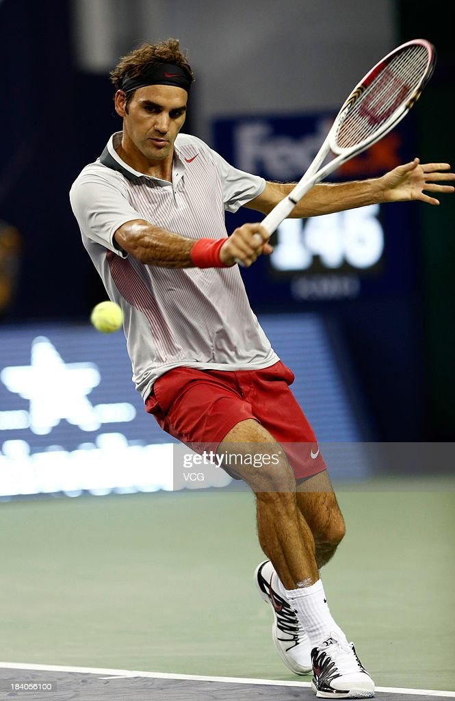 Roger Federer of Switzerland returns a ball to Andreas Seppi of Italy on day three of the Shanghai Rolex Masters at the Qi Zhong Tennis Center on October 9, 2013 in Shanghai, China.