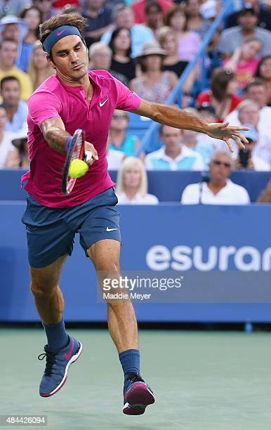 Roger Federer of Switzerland returns a forehand to Roberto Bautista Agut of Spain during Day 4 of the Western Southern Open at the Lidler Family...